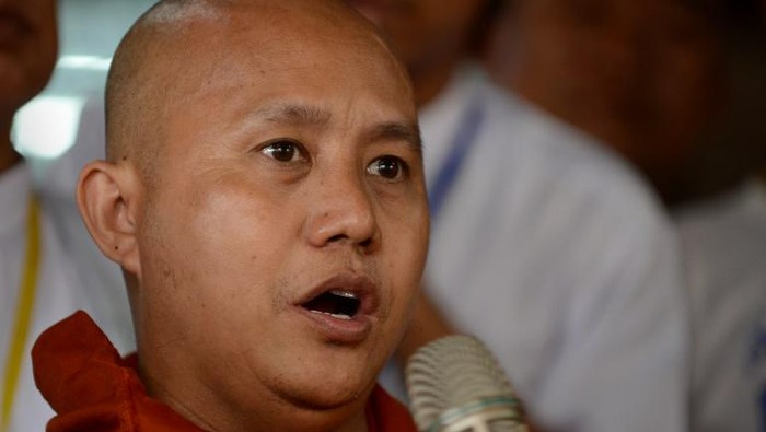 Myanmar hardline Buddhist monk Wirathu speaks to followers where over a thousand hardline Buddhists gathered at a monastery on the outskirts of Yangon on June 4, 2016, for the annual summit of their ulta-nationalist group, as the anti-Muslim network looks to bounce back from a fallout in Novembers polls.  Maroon-robed monks, as well as nuns and other followers, filled the monastery in northern Yangon to mark the third anniversary of the founding of Ma Ba Tha, a radical Buddhist movement at the forefront of anti-Muslim sentiment that has fomented across Myanmar in recent years. / AFP PHOTO / ROMEO GACAD