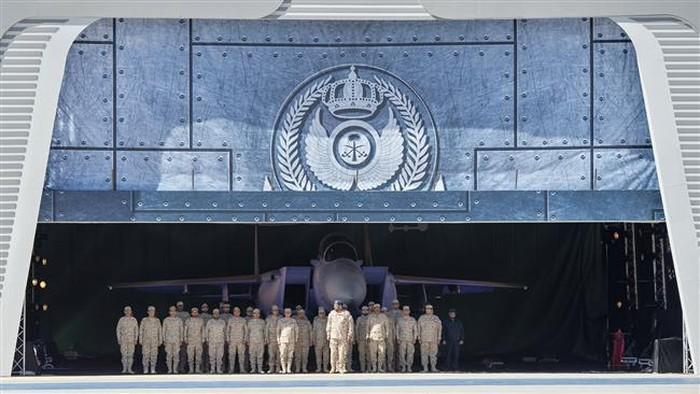 A handout picture released by the Saudi Royal Palace shows Saudi Air Force officers standing at attention in front of an advanced F-15SA fighter jet during a ceremony. (Photos by AFP)