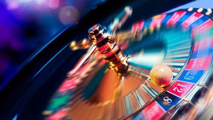 high contrast image of casino roulette in motion
