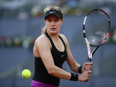 MADRID, SPAIN - MAY 08:  Winner in three sets Eugenie Bouchard of Canada shakes hands with Maria Sharapova of Russia during day three of the Mutua Madrid Open tennis at La Caja Magica on May 8, 2017 in Madrid, Spain.  (Photo by Julian Finney/Getty Images)