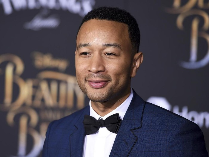John Legend arrives at the world premiere of