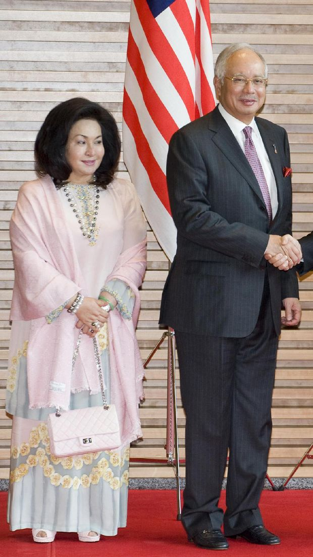 TOKYO, JAPAN - APRIL 19: Prime Minister of Malaysia Dato' Sri Mohd Najib (2nd L) shakes hands with Japanese Prime Minister Yukio Hatoyama, as their respective wive's Miyuki Hatoyama (R), and Datin Sri Rosmah Mansor (L) stand by their sides at the premier's official residence in Tokyo, Japan, 19 April 2010. Prime Minister Dato' Sri Mohd Najib and his wife are in Japan from April 18 to  21. (Photo by Toshifumi Kitamura-Pool/Getty Images)