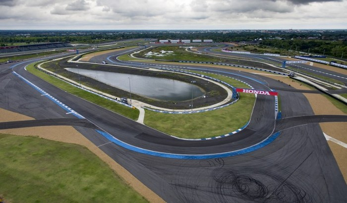 This photo taken on May 17, 2017 shows an overview of the Chang International Circuit, Thailands first FIA Grade 1 approved motorsport race track, in the northeastern Thai province of Buriram. A godfather of Thai politics is using cash and contacts to transform his once poor, forgotten rice-farming fiefdom into an unlikely sporting Camelot, complete with a football stadium and racetrack set to host the MotoGP. / AFP PHOTO / Lillian SUWANRUMPHA / TO GO WITH Thailand-politics-economy-sport, FEATURE by Sally Mairs