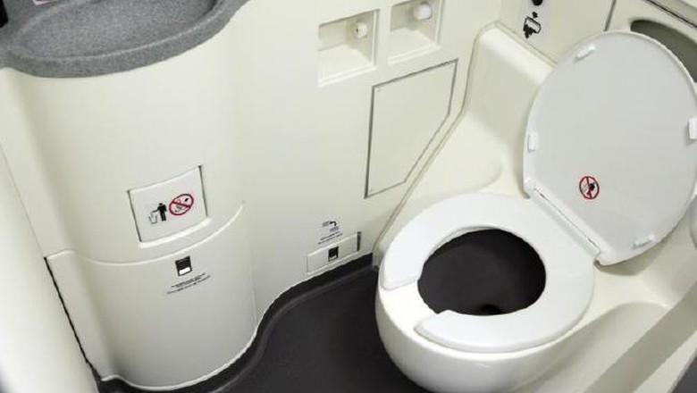 Ilustrasi toilet pesawat