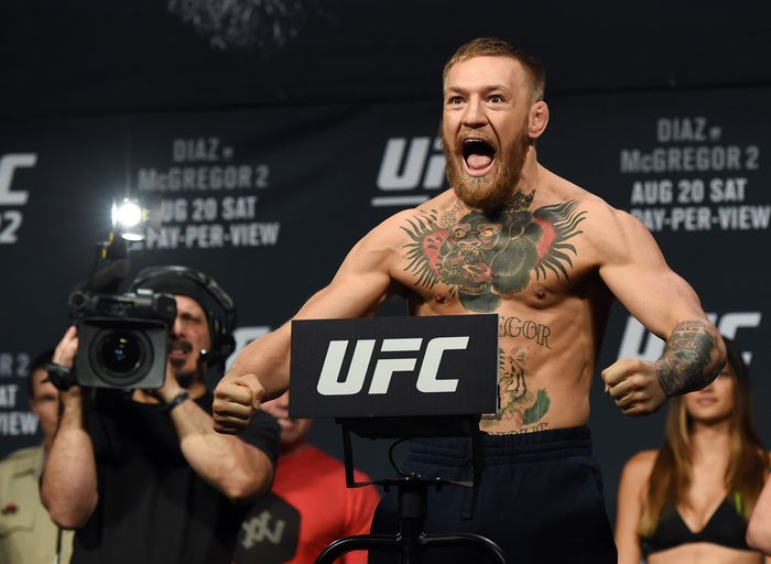 LAS VEGAS, NV - AUGUST 19:  UFC featherweight champion Conor McGregor poses on the scale during his weigh-in for UFC 202 at MGM Grand Conference Center on August 19, 2016 in Las Vegas, Nevada. McGregor will meet Nate Diaz in a welterweight rematch on August 20, 2016, at T-Mobile Arena in Las Vegas.  (Photo by Ethan Miller/Getty Images)