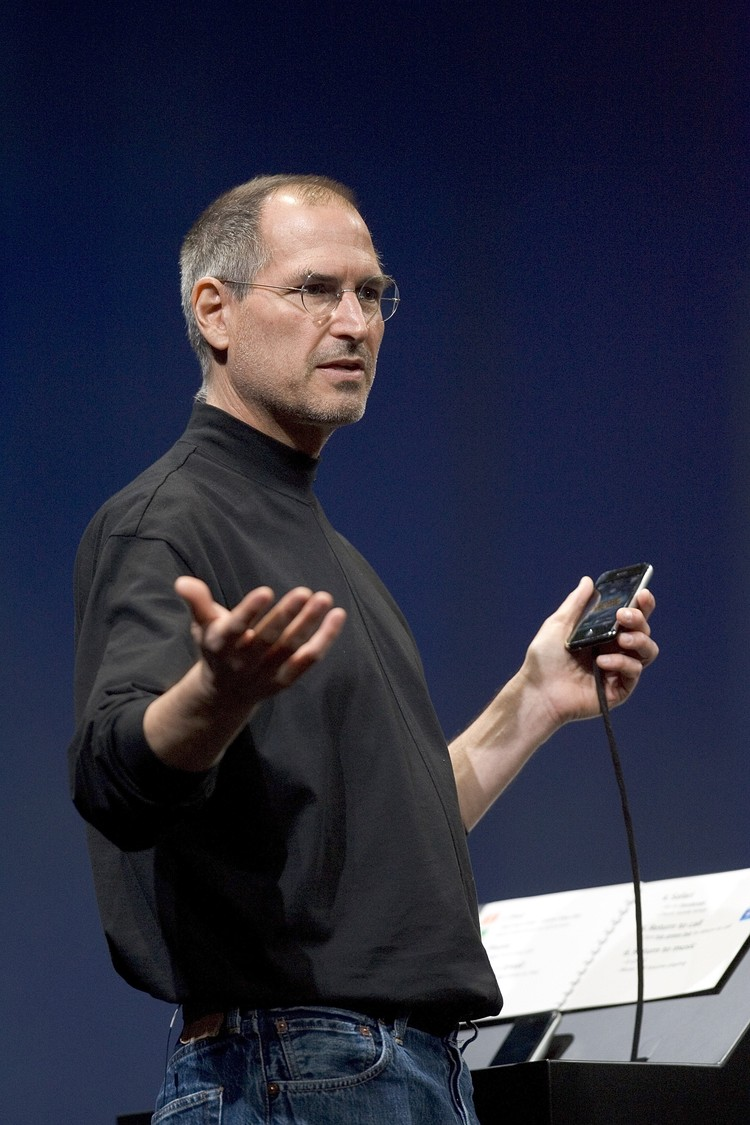 SAN FRANCISCO, CA - JANUARY 9: Apple CEO Steve Jobs gestures while delivering his keynote speech at Macworld on January 9, 2007 in San Francisco, California. During the keynote Jobs introduced the new iPhone which will combine a mobile phone, a widescreen iPod with touch controls and a internet communications device with the ability to use email, web browsing, maps and searching. The iPhone will start shipping in the US in June 2007. (Photo by David Paul Morris/Getty Images)