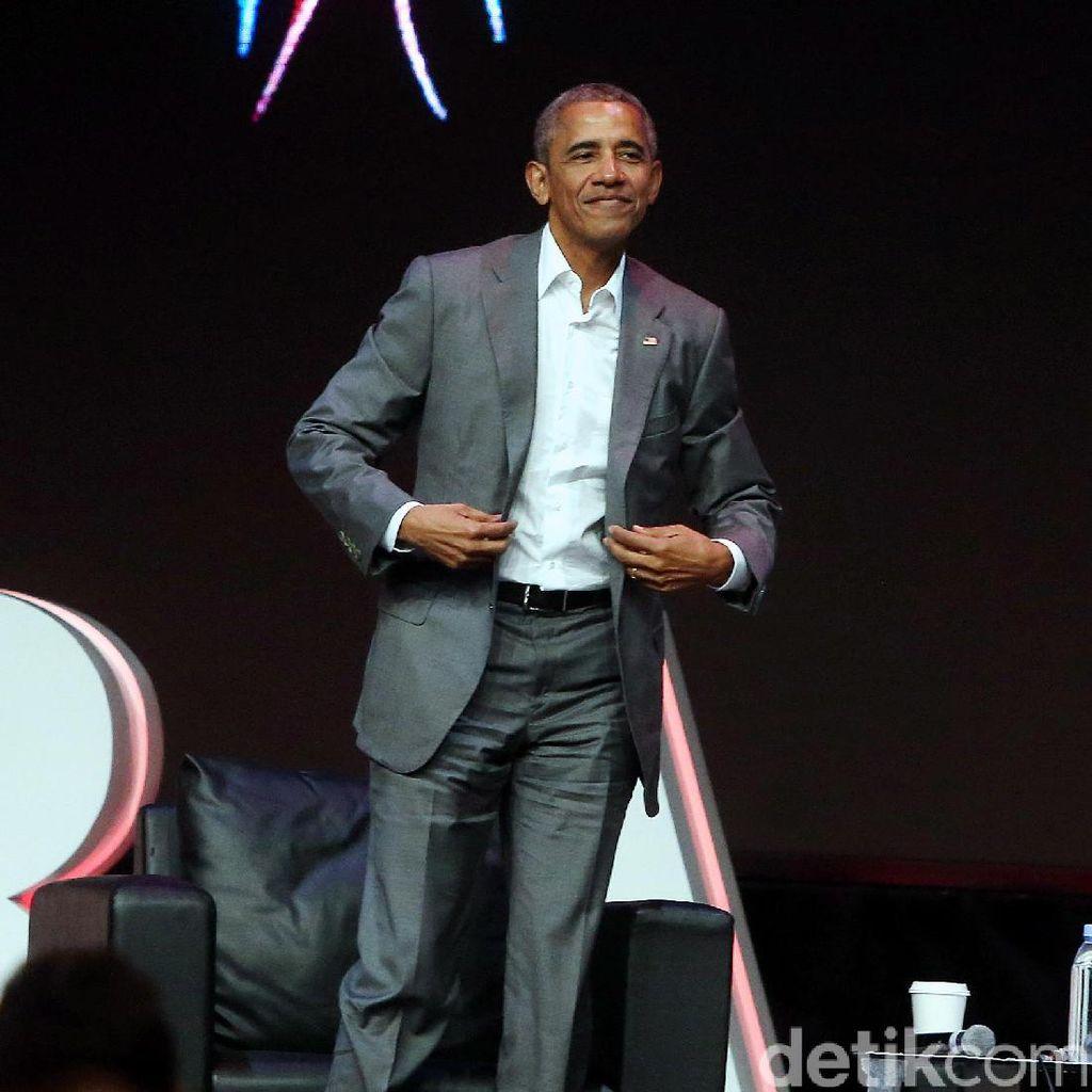 Obama Liburan Demi Keadilan Bareng George Clooney