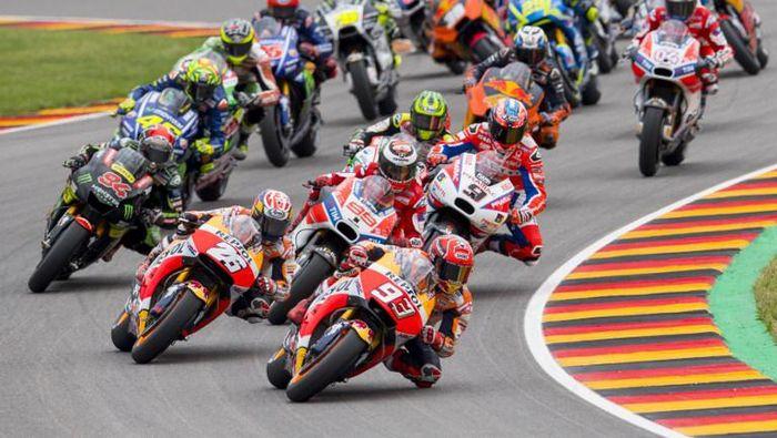 Live streaming MotoGP Jerman bisa disaksikan di detiksport. (Foto: AFP/ROBERT MICHAEL)