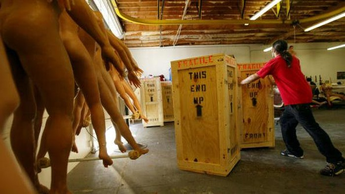 SAN MARCOS, CA - FEBRUARY 5:  A worker ships crates of finished silicone RealDoll sex dolls at the Abyss Creations factory on February 5, 2004 in San Marcos, California. RealDolls are created using Hollywood special effects technology and have orifices made of a special soft grade of silicone for people who want to