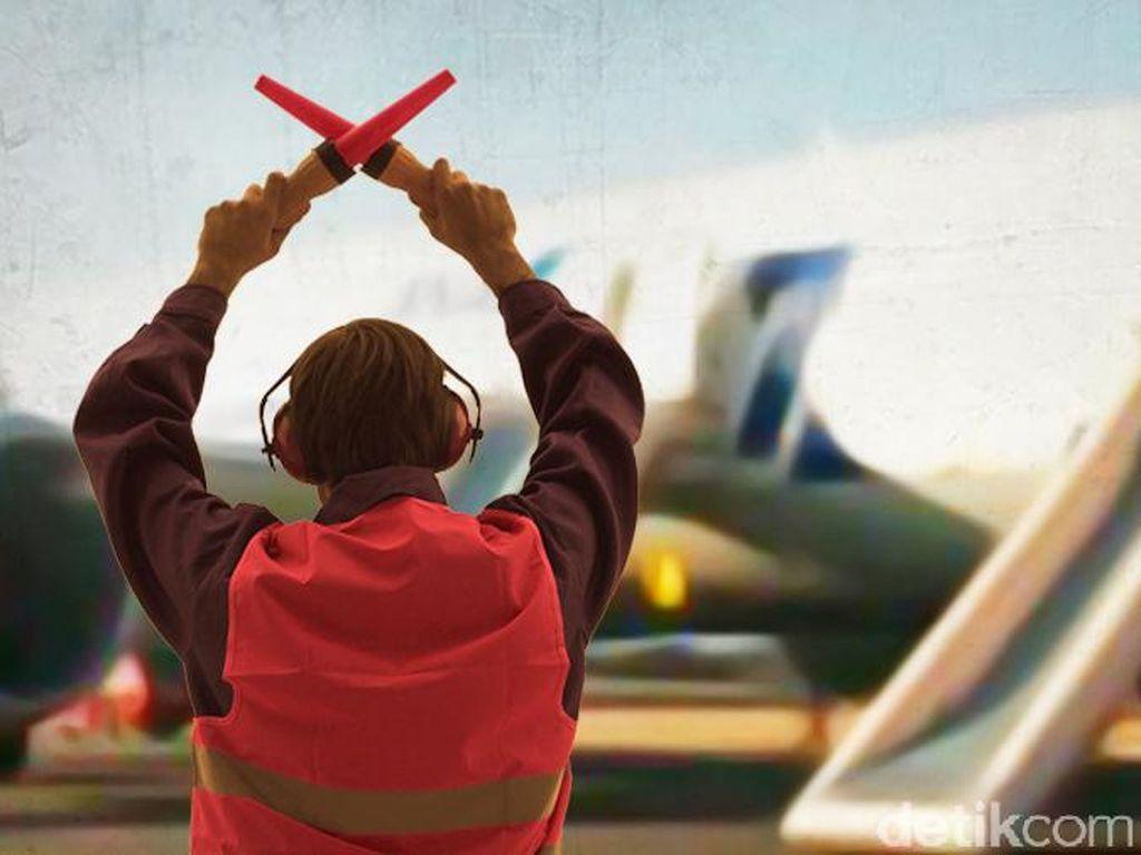 Tukang Parkir Pesawat di Bandara yang Bikin Penasaran