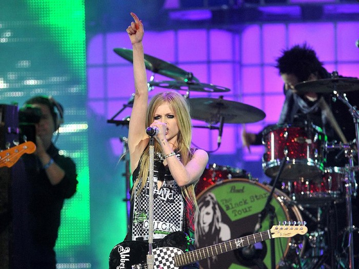 TORONTO, ON - JUNE 19:  Avril Lavigne performs on stage at the 2011 MuchMusic Video Awards on June 19, 2011 in Toronto, Canada.  (Photo by Jag Gundu/Getty Images)