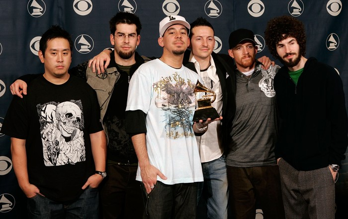LOS ANGELES, CA - FEBRUARY 08:  The group Linkin Park poses with their award in the press room at the 48th Annual Grammy Awards at the Staples Center on February 8, 2006 in Los Angeles, California.  (Photo by Kevin Winter/Getty Images)