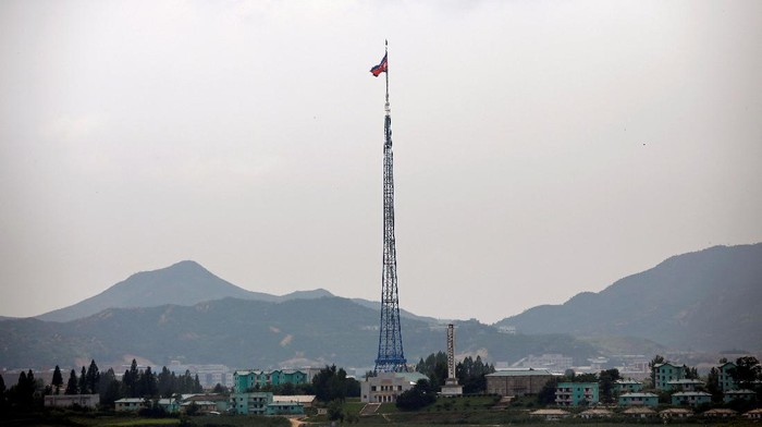 A North Korean flag flutters on top of a tower at the propaganda village of Gijungdong in North Korea, in this picture taken near the truce village of Panmunjom, South Korea July 19, 2017. REUTERS/Kim Hong-Ji