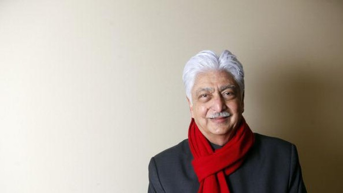 Azim Premji, chairman of Wipro Ltd., poses for a photograph following a television interview in Davos, Switzerland, on Wednesday, Jan. 25, 2012. The 42nd annual meeting of the World Economic Forum will be attended by about 2,600 political, business and financial leaders at the five-day conference. Photographer: Simon Dawson/Bloomberg via Getty Images