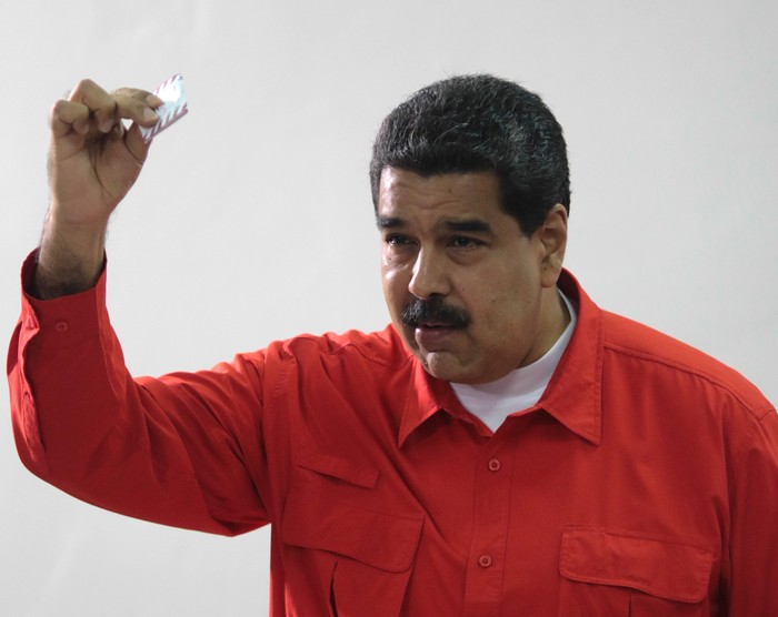 Venezuelan President Nicolas Maduro show his ballot as casts his vote at a polling station during the Constituent Assembly election in Caracas, Venezuela July 30, 2017. Miraflores Palace/Handout via REUTERS ATTENTION EDITORS - THIS PICTURE WAS PROVIDED BY A THIRD PARTY.     TPX IMAGES OF THE DAY