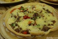 Pizza Il Migliore yang jadi menu andalan Noi Pizza.