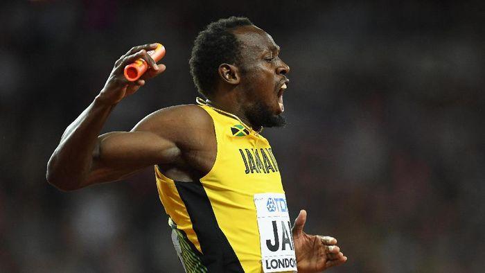 Tapi, Bolt malah menyudahi kariernya dengan catatan kurang oke. Dia meraih perunggu pada nomor 100 meter dan gagal finis di nomor lari estafet 4x100m. (Matthias Hangst/Getty Images)