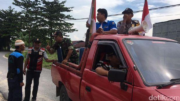 TNI-Polri Ajak Warga Pekanbaru Kibarkan Sang Merah Putih