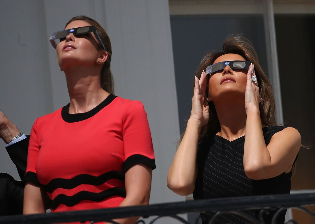 WASHINGTON, DC - AUGUST 21: First lady Melania Trump (R) and Ivanka Trump wear special glasses to view the solar eclipse at the White House on August 21, 2017 in Washington, DC. Millions of people have flocked to areas of the U.S. that are in the