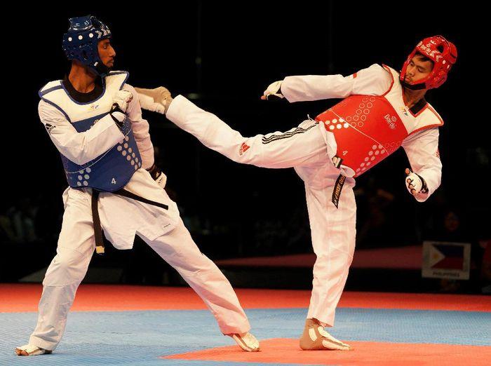Pertandingan Taekwondo. (Foto: Sigid Kurniawan/ANTARA FOTO)
