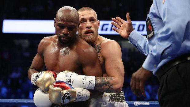 Conor McGregor menantang Floyd Mayweather Jr. bertarung di arena UFC.