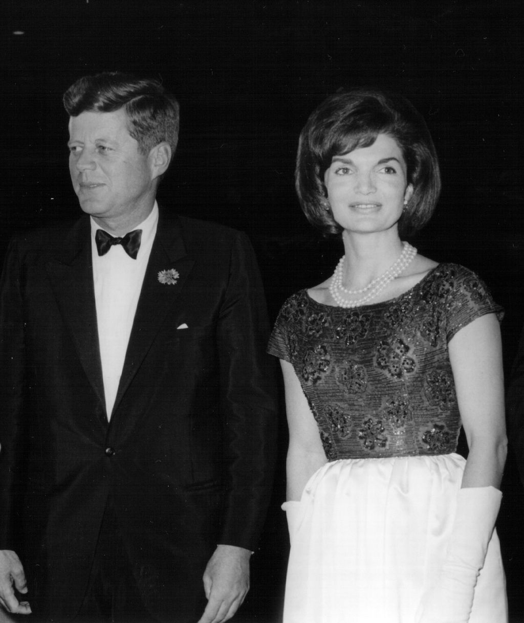 381091 52: President John F. Kennedy speaks during a press conference as First Lady Jackie Kennedy looks on April 9, 1963 at the White House House. (Photo by National Archive/Newsmakers)