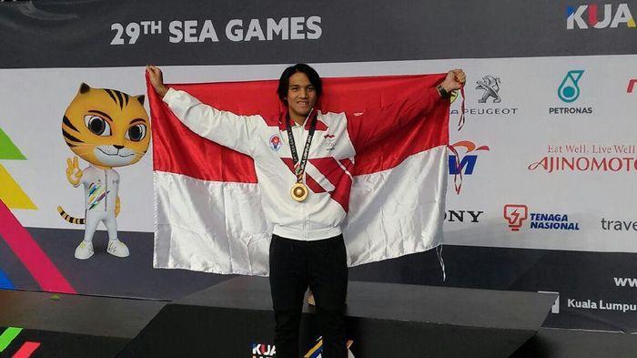 Gagarin Nathaniel Yus menambah koleksi emas dari cabang olahraga renang, emas ketiga, sekaligus menjadi emas ke-20 untuk Indonesia. Gagarin menjadi yang tercepat di nomor 100m putra gaya dada.(dok. PB PRSI)0