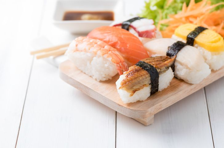 sushi with sauce and wasabi on old white wood plate, Japanese food