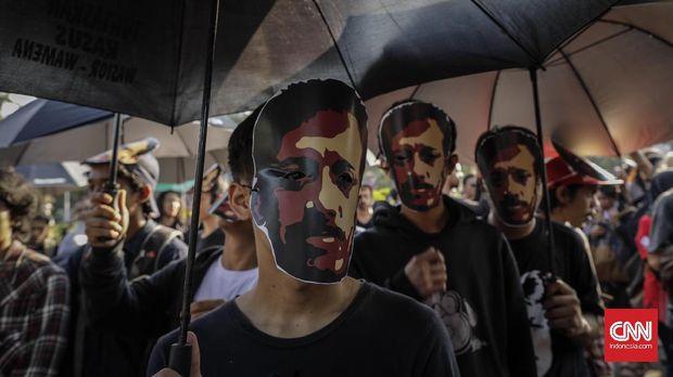 Jokowi dan Aksi Saling Lempar Kasus Munir