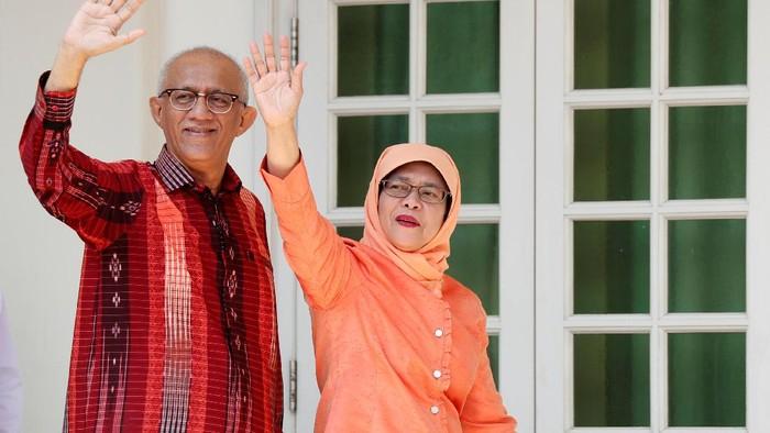 Halimah Yacob dan suaminya, Mohammed Abdullah (REUTERS/Edgar Su)