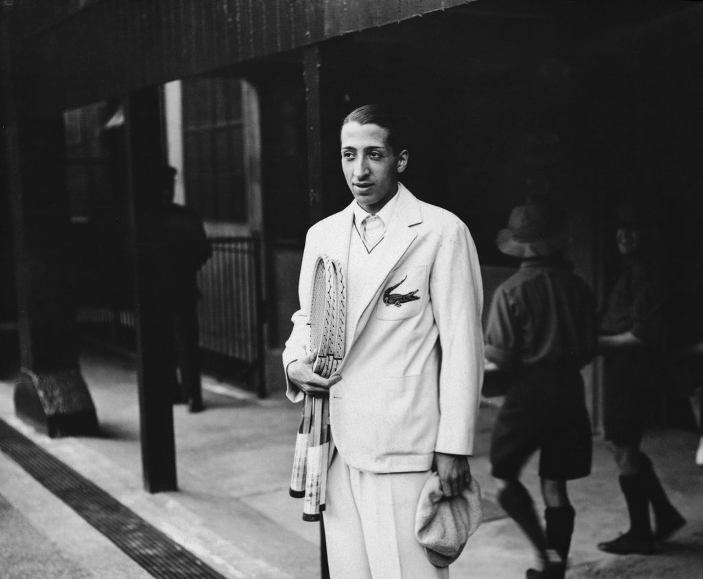 French Tennis player Rene Lacoste, one of France's 'Four Musketeers' who won the Davis Cup in 1932, at Wimbledon. He is wearing his embroidered crocodile motif.  Original Publication: People Disc - HH0434   (Photo by Topical Press Agency/Getty Images)
