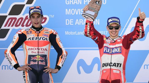 Marc Marquez dikabarkan kesal dengan keputusan Alberto Puig yang memilih Jorge Lorenzo.