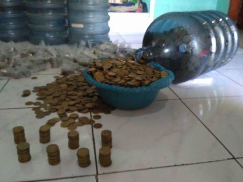 Nabung Uang Receh, Wanita Ini Bisa Punya Rp 60 Juta