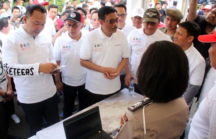 Hal ini sebagai bentuk dukungan bank DKI dalam perluasan layanan pembayaran e-Samsat yang ditandatangani secara bersama stakeholder terkait. Foto: dok. Pemprov DKI