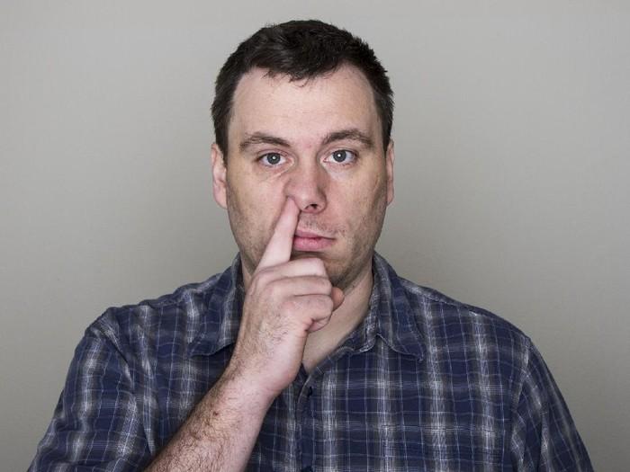 Penyebab hidung penuh upil saat tidur adalah karena pemakaian ACdan pemakaian seprai yang tidak bersih/Foto: Thinkstock
