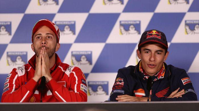 Andrea Dovizioso dan Marc Marquez (Foto: Robert Cianflone/Getty Images)
