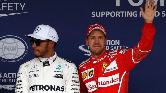 Lewis Hamilton bersama Sebastian Vettel (Foto: Toru Hanai/Reuters)