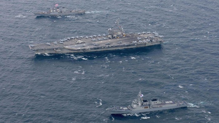 The Navys forward-deployed aircraft carrier USS Ronald Reagan and the forward-deployed Arleigh Burke-class destroyer USS Stethem steam alongside ships from the Republic of Korea Navy in the waters east of the Korean Peninsula on OctoBer 18, 2017. Picture taken on October 18, 2017.   Courtesy Kenneth Abbate/U.S. Navy/Handout via REUTERS    ATTENTION EDITORS - THIS IMAGE HAS BEEN SUPPLIED BY A THIRD PARTY.