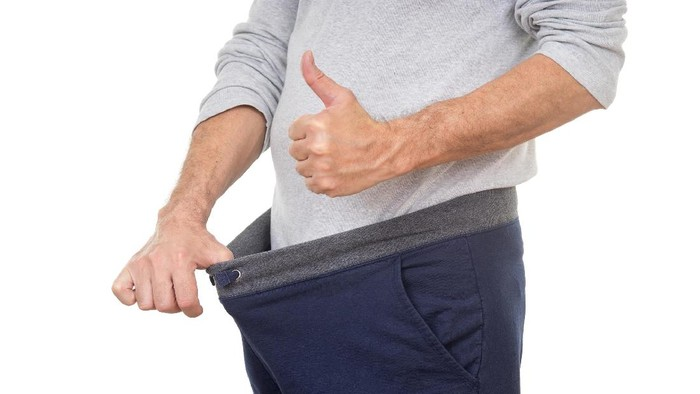old man looking in his pants and showing thumbs up