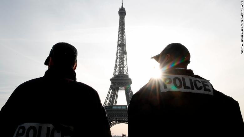 Police patrol in front of the Eiffel Tower in Paris last week as France officially ended a state of emergency. (Christian Hartmann/AFP/Getty Images)