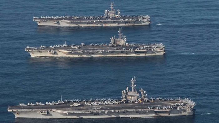 The aircraft carriers USS Ronald Reagan (CVN 76), USS Theodore Roosevelt (CVN 71) and USS Nimitz (CVN 68) are underway, conducting operations, in international waters as part of a three-carrier strike force exercise in western Pacific, November 12, 2017.   Courtesy James Griffin/U.S. Navy/Handout via REUTERS  ATTENTION EDITORS - THIS IMAGE HAS BEEN SUPPLIED BY A THIRD PARTY.