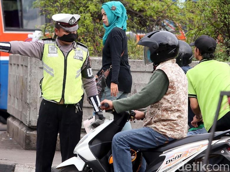 Ilustrasi Satlantas Aceh Besar parodi tilang. Foto: Rengga Sancaya
