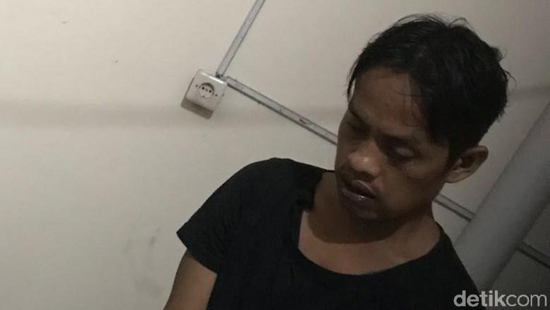 Tangan Diborgol, Ini Tampang Pelaku Kasus Mayat di Kampung Rambutan