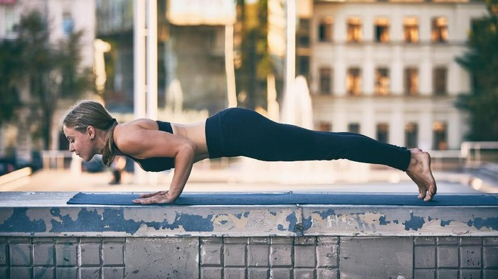 Fit woman doing push-ups in gym
