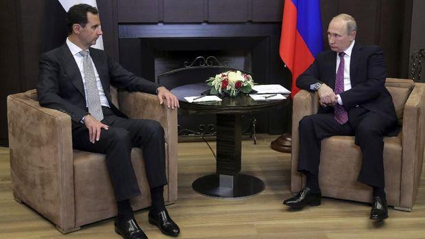 Assad saat bertemu Putin di Sochi, Rusia