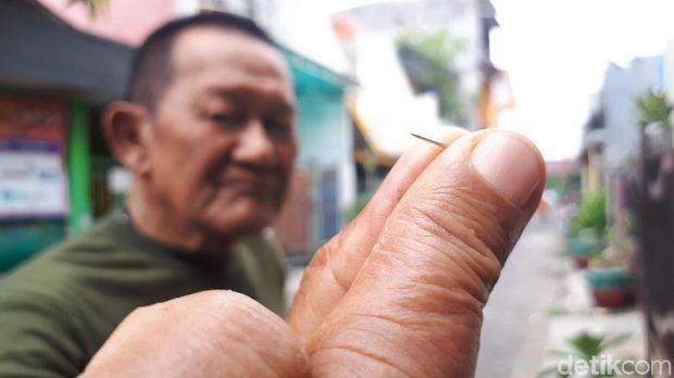 Djoni Liem Sang Penyembur Jarum Beracun/