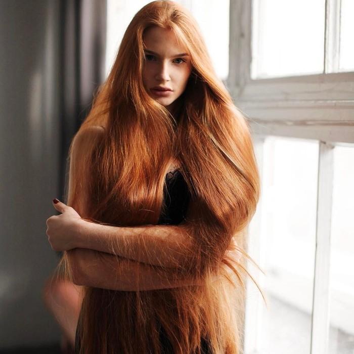 Anastasiya Sidorova (24) adalah seorang model asal Rusia yang terkenal karena memiliki rambut panjang berwarna merah. Karena rambutnya itu ia dijuluki sebagai Rapunzel dunia nyata. (Foto: Instagram/sidorovaanastasiya)