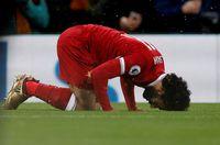 Mohamed Salah melakukan sujud setelah mencetak gol (Lee Smith/REUTERS)