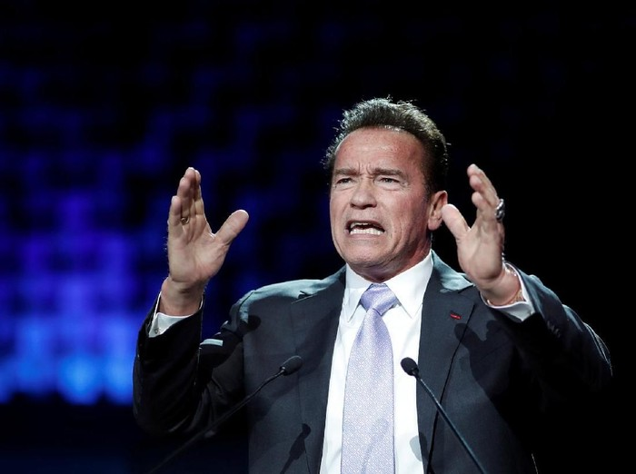 R20 Founder and former California state governor Arnold Schwarzenegger delivers a speech during the One Planet Summit at the Seine Musicale center in Boulogne-Billancourt, near Paris, France, December 12, 2017. REUTERS/Benoit Tessier