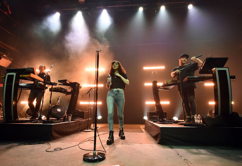 LAS VEGAS, NV - APRIL 21:  (L-R) Recording artist/producer Iain Cook, singer Lauren Mayberry, and recording artist/producer Martin Doherty of Chvrches perform at Brooklyn Bowl Las Vegas on April 21, 2016 in Las Vegas, Nevada.  (Photo by Ethan Miller/Getty Images)